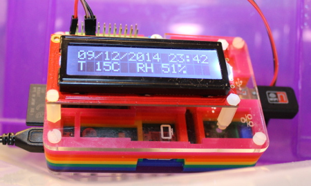 MyPiFi LCD display mounted on a Raspberry Pi installed in a Pimoroni Pibow case - pcb mounts