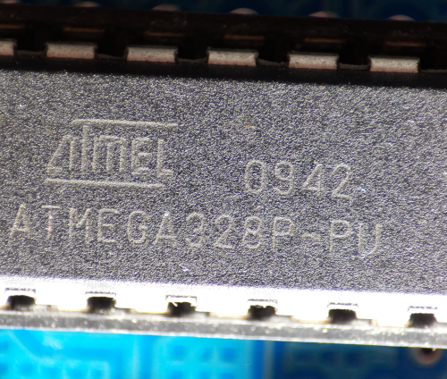 Photo of a ATMEGA328p taken with a Raspberry Pi HQ camera and a microscope